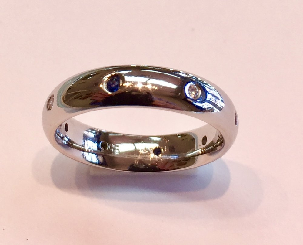 Item No AB USD875  Platinum Sapphire and Diamond Ring/Band  A stunning high quality substantial ring with alternating blue sapphire and diamonds.  Elegance, class and timelessness.  Currently a US size 7.5 but can be sized.  10.1 grams