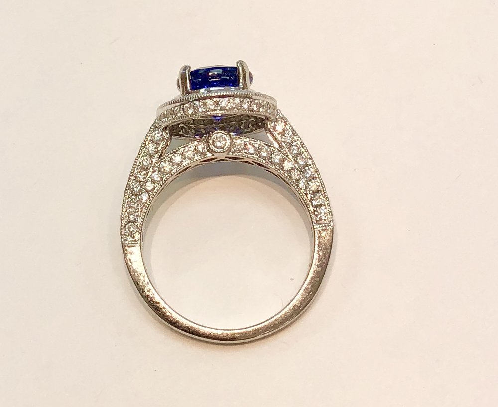 Item No AB194 USD1,345  14k White Gold Diamond Sapphire Ring  OMG ! This is just an amazingly beautiful ring. A two carat perfect sapphire (a lab made one, but please do not let that put you off) with the most exquisite pave diamond and milgrain work you will find. Super nice white clear diamonds of approximately a carat in weight.   Make a wonderful engagement or everyday ring.