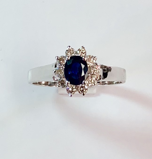 Item no.174  US$425  Stamped 14k White Gold Sapphire and Diamond ring.  Classic style with .5 carat centre stone and 15 points of diamonds surround.  Ring head measures 8mm x 8mm   2.3 grams