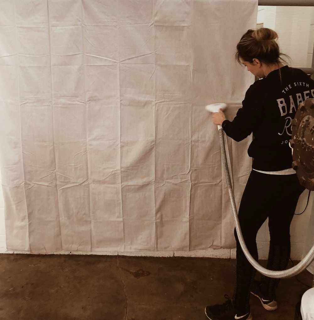 Steaming the canvas gets the creases out so they don't become a permanent part of the backdrop