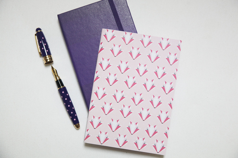 Fox notebook   in pink by   SketchInc   at Etsy    Purple   notebook by   Moleskine