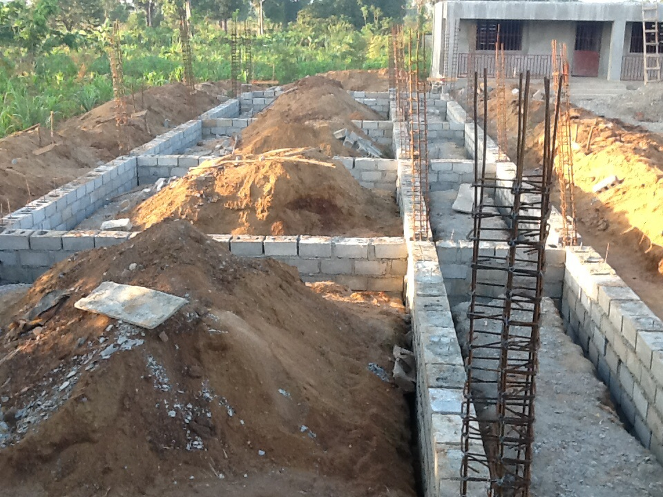 Constructing foundation for additional rooms at school