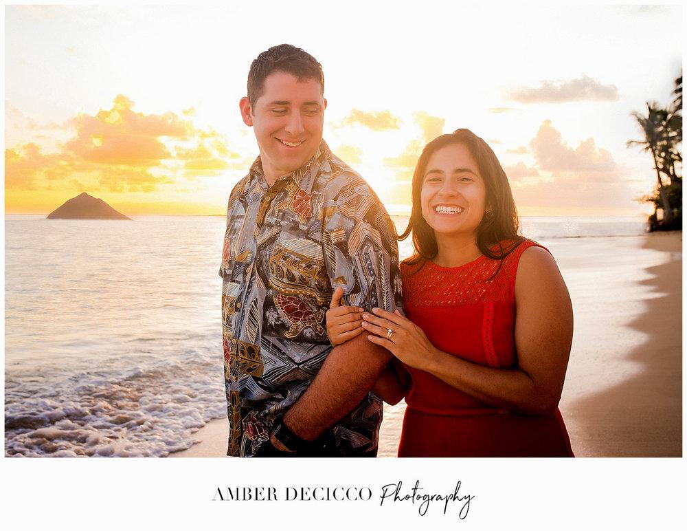Engaged couple at sunset on Lanikai Beach