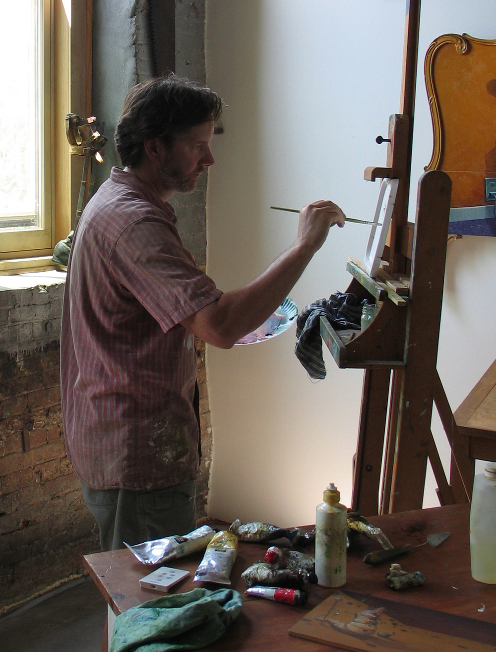 My easel is nearly vertical. I alternate between sitting and standing. Although I usually forget to, it helps a lot to step back and look at the painting from a distance. At my old studio in Brooklyn, 2011.