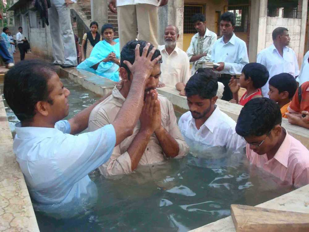 Das baptises a new believer in the church he planted at the Missionary Training Centre