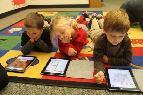 Young Students With iPads in Class