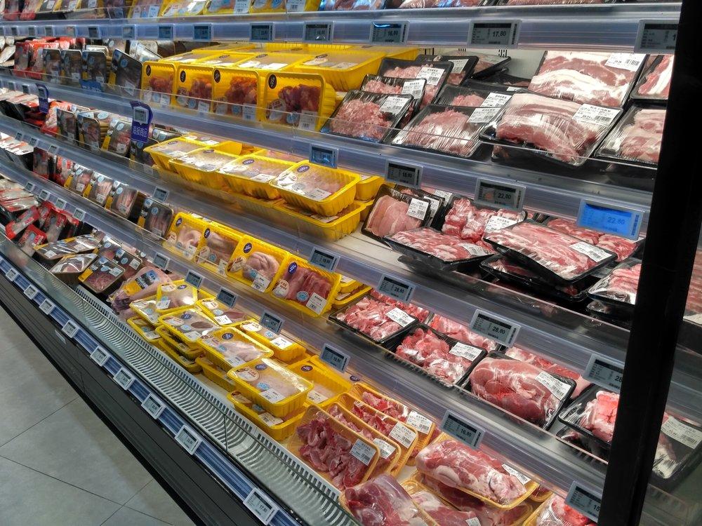 Digital price labels here fridge shelvings for fresh meat