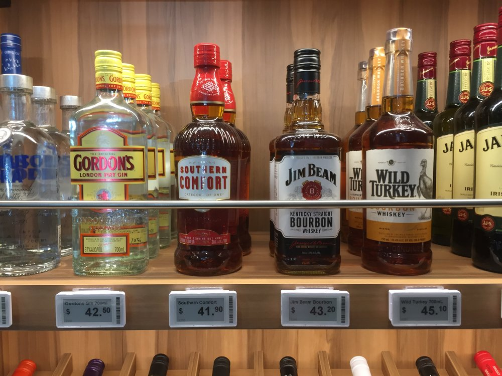 Sydney bottle shop liquor display with digital price tags