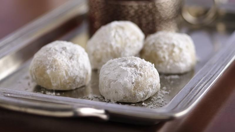 Russian Tea Cookies: 1cup butter 1/2cup powdered sugar 1teaspoon vanilla 2 1/4cups all-purpose flour 3/4cup finely chopped Macadamia nuts 1/4teaspoon salt Powdered sugar for coating Directions: Heat oven to 400ºF. Mix butter, 1/2 cup powdered sugar and the vanilla in large bowl. Stir in flour, nuts and salt until dough holds together. Shape dough into 1-inch balls. Place about 1 inch apart on ungreased cookie sheet. Bake 10 to 12 minutes or until set but not brown. Remove from cookie sheet. Cool slightly on wire rack. Roll warm cookies in powdered sugar; cool on wire rack. Roll in powdered sugar again.