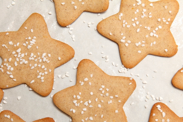 Pepparkakor// Swedish Gingerbread Cookies: 3 1/2 cups all-purpose flour 2 teaspoons ground ginger 2 teaspoons ground cinnamon 2 teaspoons ground cloves 1 teaspoon baking soda 1/2 teaspoon salt 1/2 cup dark corn syrup 1 teaspoon freshly grated orange zest 1 cup (2 sticks) unsalted butter, cut into pieces 1 cup sugar 1 large egg, lightly beaten Pearl sugar (for dusting) Directions: In a large bowl, whisk together the flour, ginger, cinnamon, cloves, baking soda, and salt. In a small saucepan over moderate heat, warm the corn syrup and orange zest. Add the butter and sugar and continue warming, stirring occasionally, until melted. Remove from the heat and let cool to room temperature. Add the egg and whisk to combine. Pour over the flour mixture and stir to combine. Form the dough into a ball, wrap in a double layer of plastic wrap, and chill overnight. Arrange racks in the upper and lower thirds of oven and preheat to 375°F. Line 2 large baking sheets with nonstick baking mats,or parchment paper. Using a lightly floured rolling pin, roll out a portion of the dough on a lightly floured surface to a 1/4 inch thickness. Using cookie cutters, cut the dough into desired shapes, such as circles, stars, hearts, bells, gingerbread men, and Christmas trees. Transfer to the prepared baking sheets and sprinkle with the pearl sugar. Bake, switching the cookies between the upper and lower racks and rotating the baking sheets about halfway through baking, until the edges are just beginning to brown, 7 to 8 minutes. Watch the cookies carefully to make sure they don't get too brown. Let the cookies cool on baking sheets for 5 minutes before transferring to a wire rack to let cool completely. Continue rolling and cutting out the rest of the cookie dough and baking the cookies on cooled baking sheets.