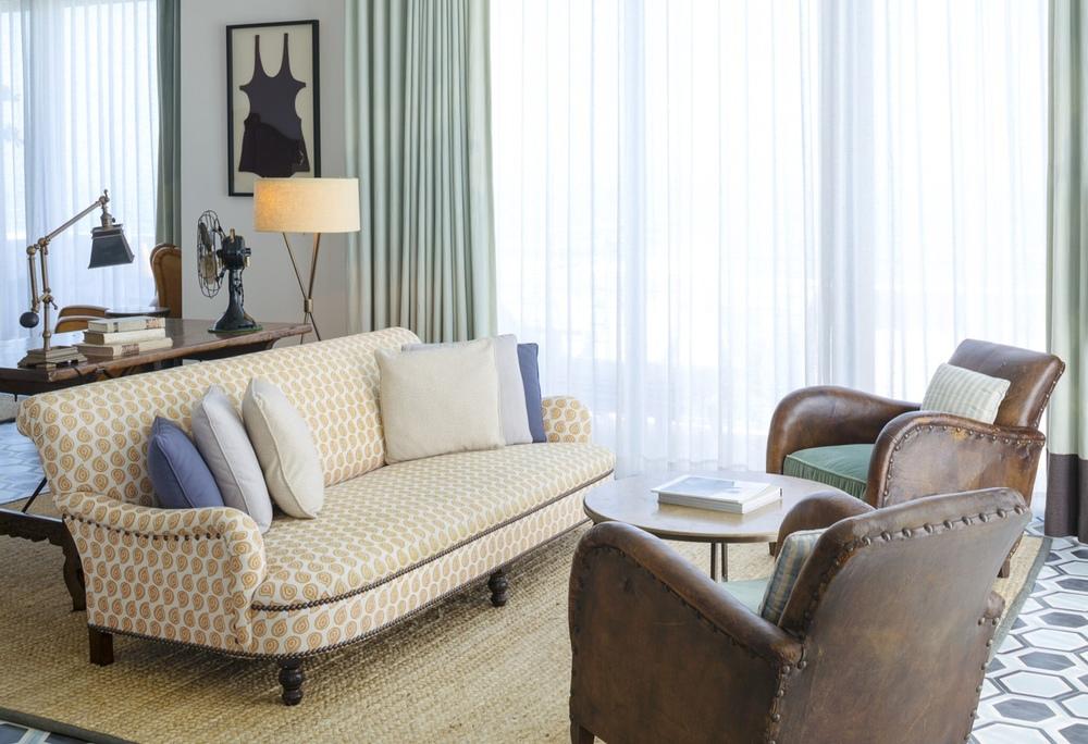 "Cocktail Table No. 1, (32"" diameter x 16"" H, walnut travertine limestone), Guest Room, Soho Beach House, Miami"