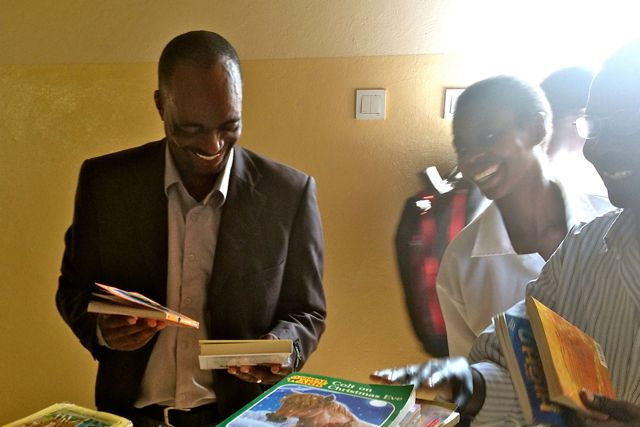 The Boane school director and some of the teachers are thrilled with new books
