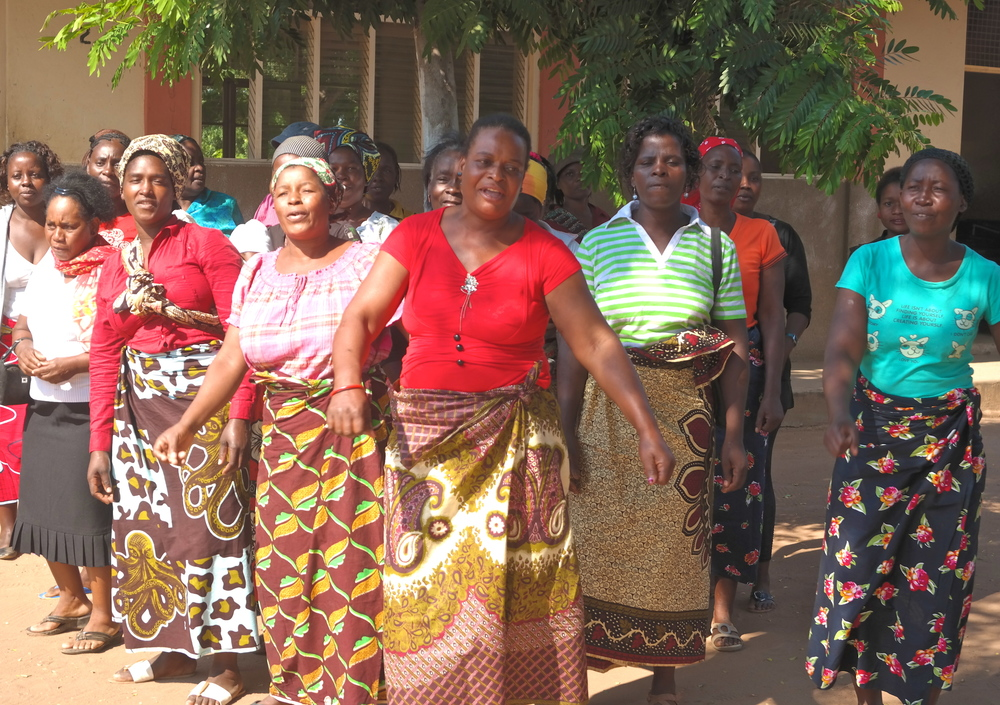 Women from the Boane area greeting the students and faculty from Weber State University to Mozambique.