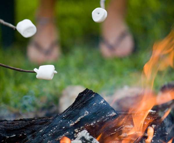 Roasting marshmallows over a campfire