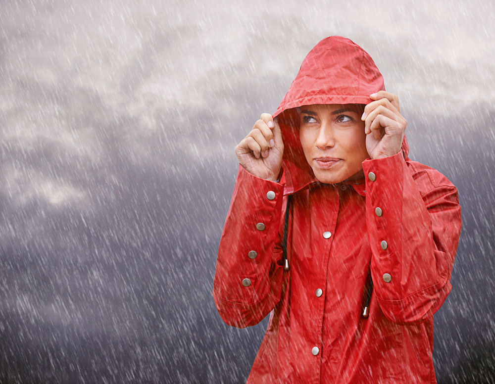 Woman in a raincoat in the rain Image: Getty Images