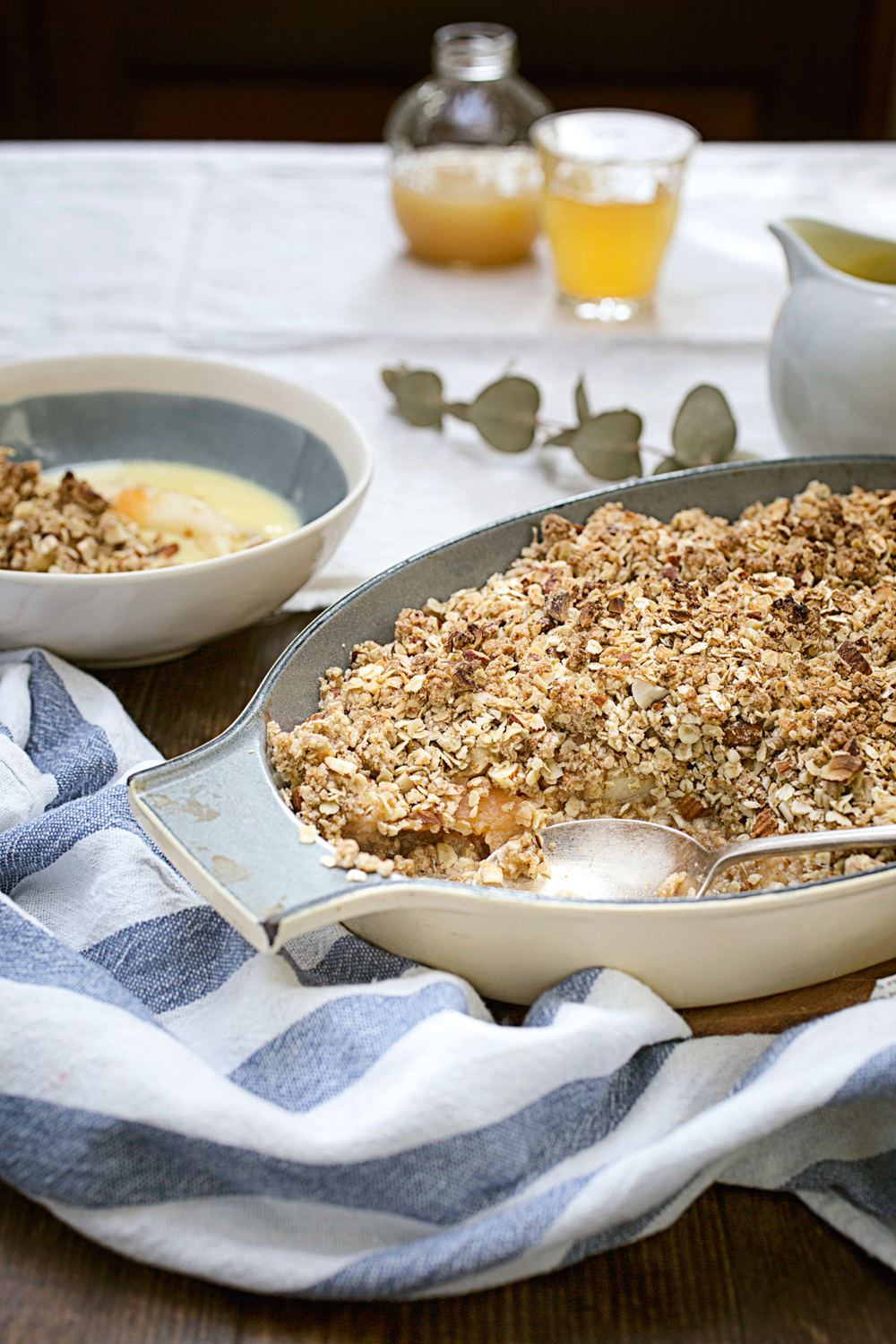 Nutty crumble and indulgent almond custard bring out the best in delicious poached pears and quince