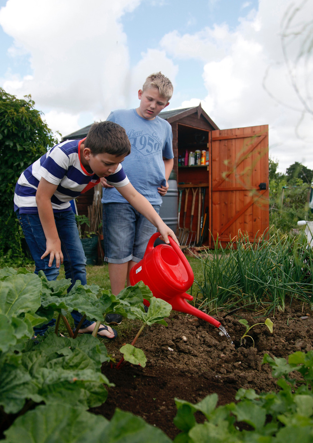 Jack and Luke planting butternut squash_Mick_Webb (2).jpg