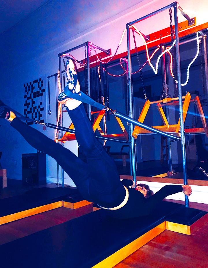 leg springs in the air_flesh and bone pilates.jpg