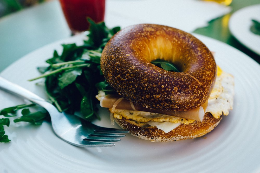 """If you want to celebrate Labor Day by sleeping in and catching up on your favorite shows, we promise we won't judge you. After all, September 4th is a day to celebrate all of your hard work. If you feel like stepping out for a bite to eat, here are a few Chicago restaurants serving up Labor Day brunch specials all weekend!  WHISK 2018 W Chicago Avenue If you're heading over to West Town and Ukrainian Village, you'll want to make a reservation at Whisk. Their motto is """"Brunch by Day, Burgers by Night,"""" so no matter what you're in the mood for, Whisk will serve it up right. We hear their basil tomato tortilla filled with scrambled eggs and guacamole is pretty good. For the full brunch menu, go here. Call 773-252-9060 for reservations.  BEATRIX RIVER NORTH 519 North Clark Street Make your Labor Day brunch complete at this cozy Northshore coffeehouse. They're known for having a neighborhood vibe, delicious pastries, and some of the best coffee in town. If a cocktail bar is a brunch must then Beatrix River North is for you. The full menu can be found here.Call 312-284-1377 for reservations."""