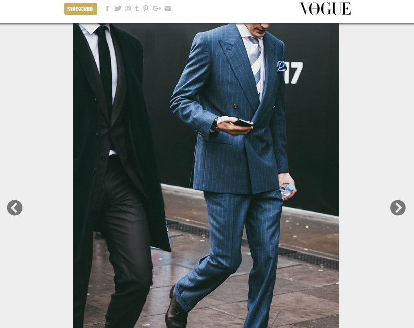 Blogger Anton Welcome (@antonjwelcome) wearing a GANDHUM Prince of Wales suit alongside Andrew Jarman from A Gentleman's Guidance (@gentsguidance). Photographed by Jonathan Daniel Pryce on Vogue Paris during LFWM.