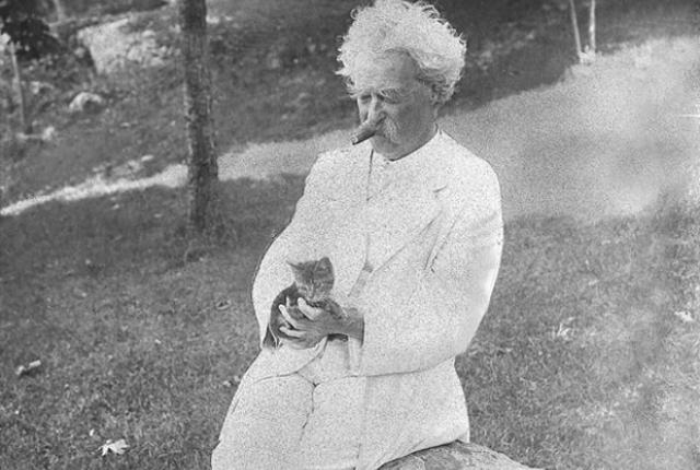 Mark Twain with his cat.