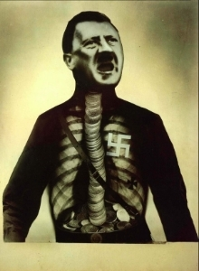 John Heartfield's  Adolf Hitler the Superman Swallows Gold and Shits Tin , 1932.