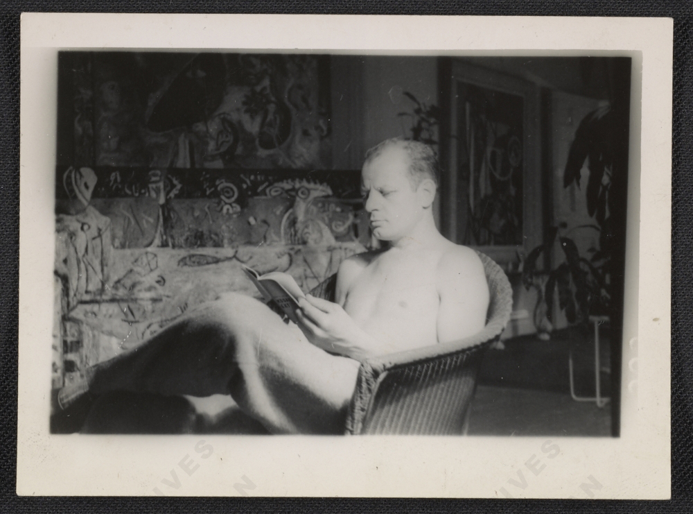 Pollock reading in 1943, Guardians of the Secret in the background.
