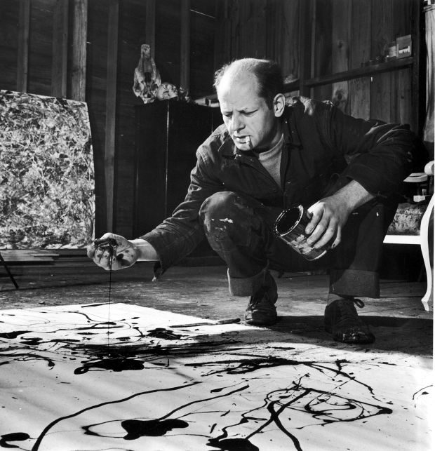 Pollock painting in his studio.