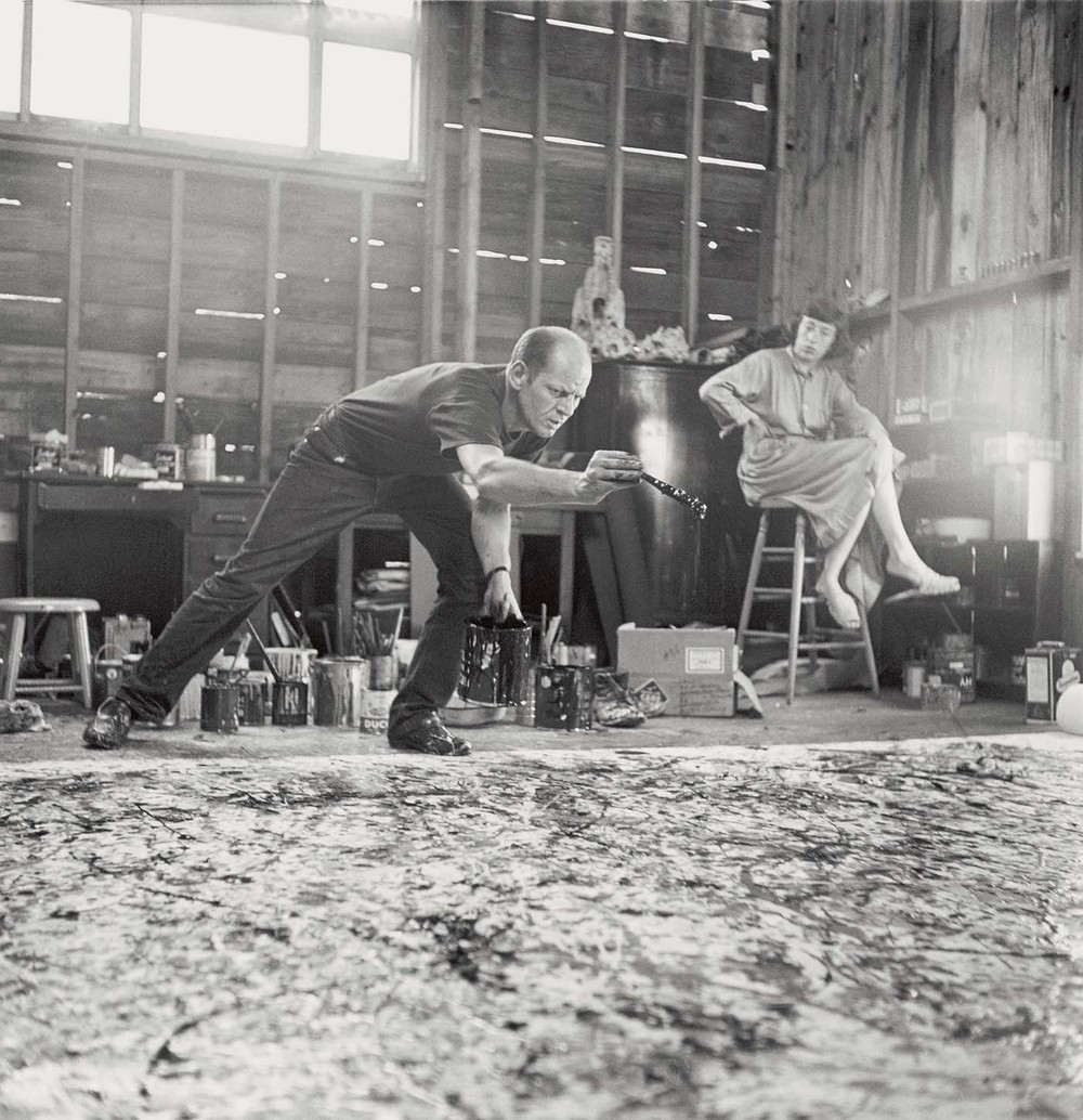 Pollock painting in his studio with Krasner.