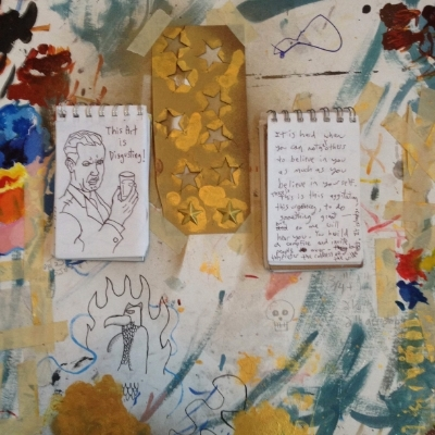Notebooks with sketches and writings with studio detritus...