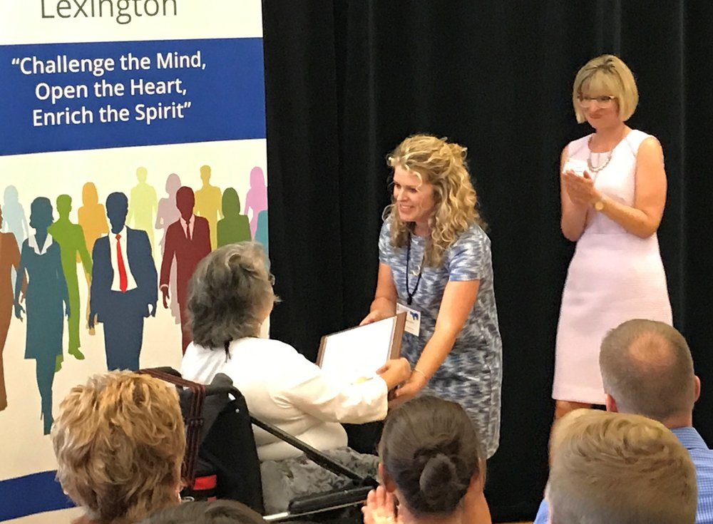 Amy E. Dougherty receiving her Leadership Lexington graduation certificate from Amy Carrington, Leadership Lexington Director.