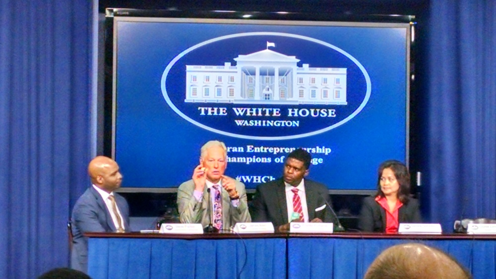 CEO Jim Allen (2nd from left) explaining the meaning behind the Honor Capital logo at the White House