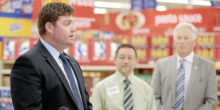Tulsa Operator Jared O'Malley thanks community support as CEO Jim Allen looks on at the Tulsa store opening November 11, 2015