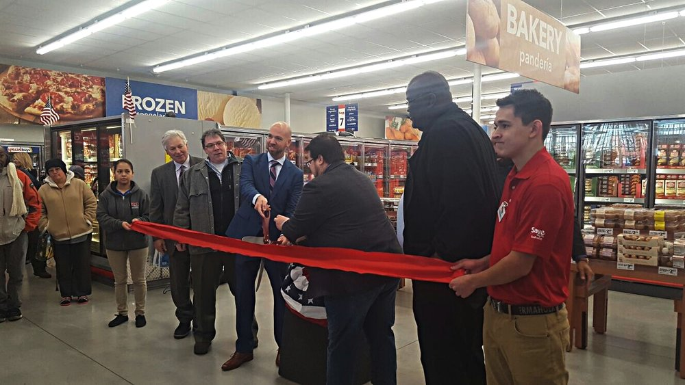 Wichita, KS ribbon cutting with Honor Capital's Matt Eisenbach, Councilman Clendenin, and Jon Clarke of Enterprise Community Partners