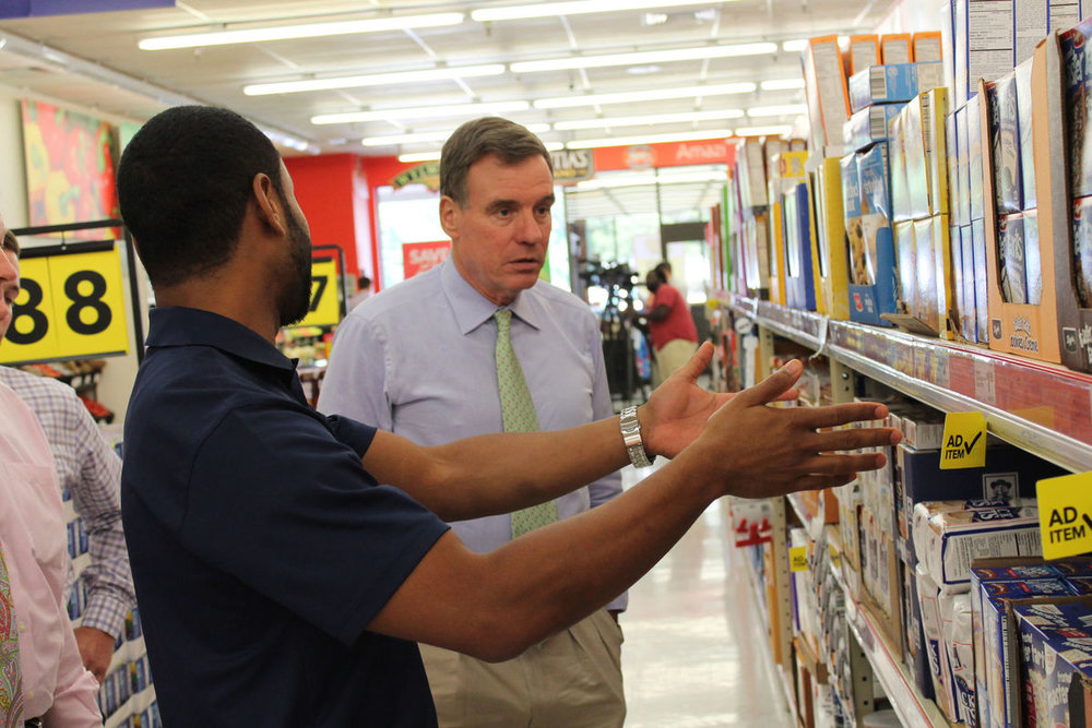 Honor Capital's Marcus Scarborough explains everyday low pricing to Senator Warner