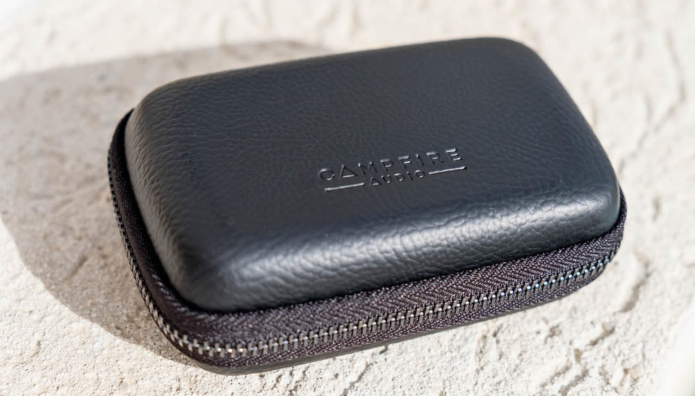 New hard headphone carry case for the Vega has black deep grain leather with the Campfire Audio logo embossed on the top.