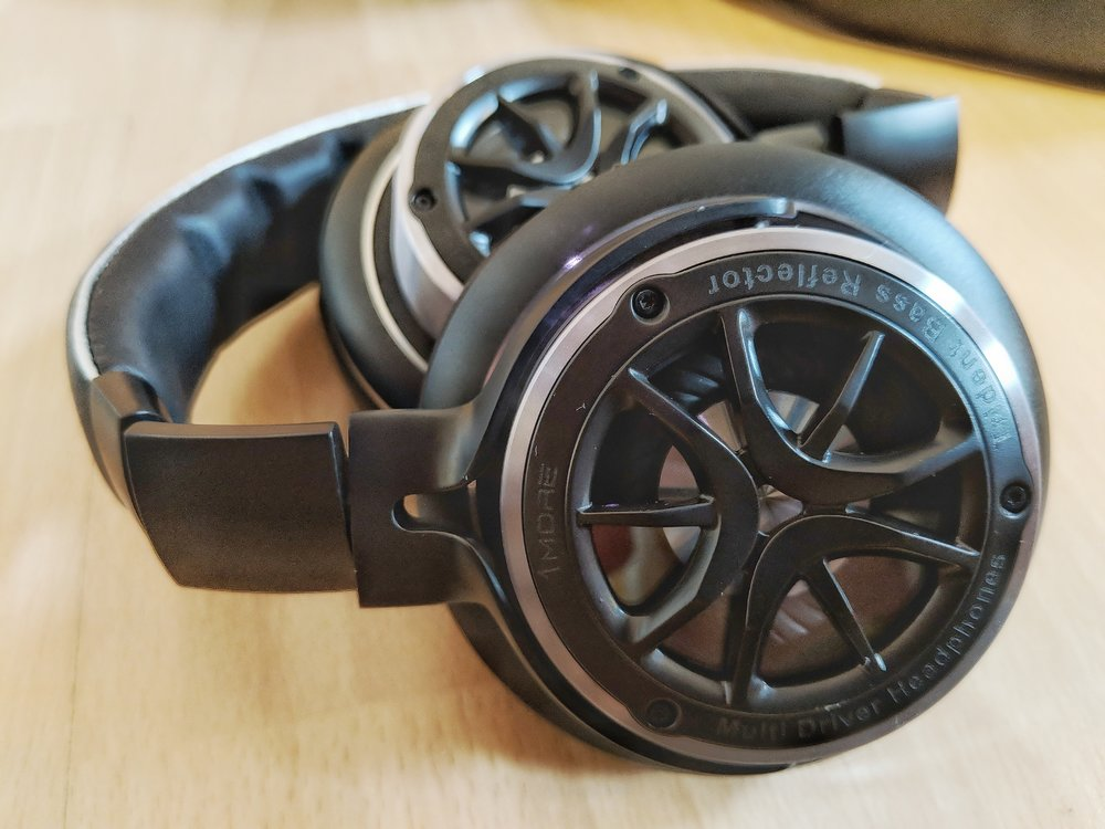 despite the appearance the 1more triple driver over ear headphone is actually closed back with a viewing plate over the main bass diaphram.