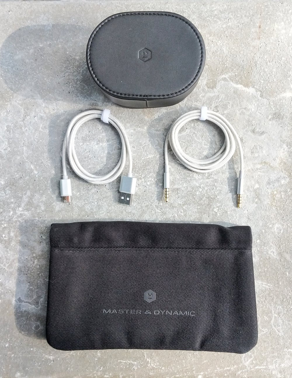 Master & Dynamic MW50 headphone accessories. USB-c charging cable and 3.5mm input cable. Softshell carry case and leather earpad case.