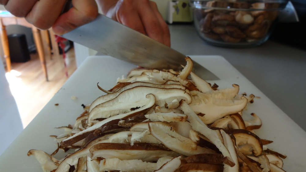 Slicing fresh shiitake mushrooms for pickling