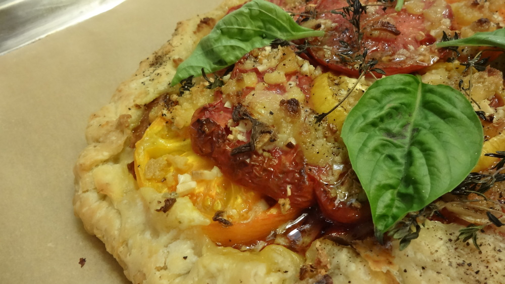 Local heirloom tomato galette is a perfect summertime treat--let me show you how easy and fun it can be to make!