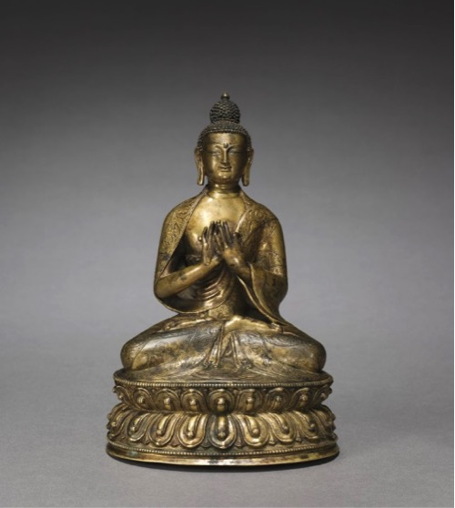 "Figure 1. ""The Cleveland Buddha"", ca. 1400, Western Tibet. Bronze, H. approx. 7 inches. Currently at The Mary and Leigh Block Museum of Art, on loan from The Cleveland Museum of Art. Image taken from: Rob Linrothe, Collecting Paradise: Buddhist Art of Kashmir and Its Legacies, (New York: Rubin Museum of Art, Evanston: Northwestern University, Mary and Leigh Block Museum of Art) 2014, p. 200."