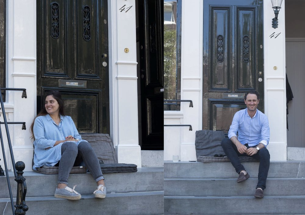 Jette and Tom sit on stoops in Amsterdam