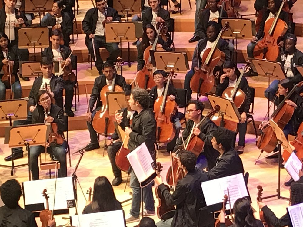 Gustavo Dudamel addresses audience and orchestra at Disney Hall, July 2017 (Willie is just behind the cellist to the left of Dudamel's face. Click photo for a nice LA Times article about the project.)