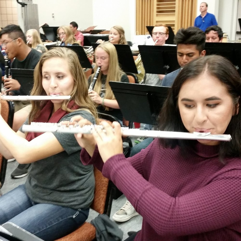 flutists in rehearsal