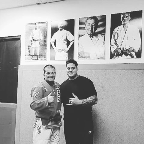 Humbled and excited to be learning from a legend like Carlos Machado. The pictures above us is the lineage from the origins of Jiu Jitsu and Carlos comes after the last picture... crazy. Have to thank my friends and family again for getting me in to bjj. I'm addicted already. #suckingWind #gettingtappedoutbydudeshalfmysize #cantcatchmybreath  #machadobjj