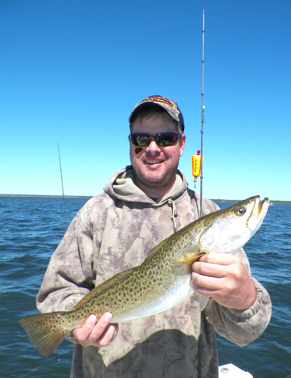 "Jack Byrd with a beautiful 23"" trout taken on a live pinfish under a Back Bay Thunder"