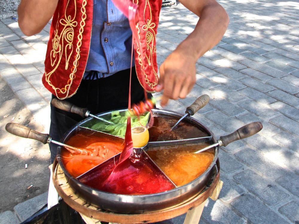 a street vendor twirls osmanli macunu in Sultanehmet