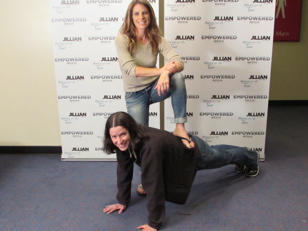 Jillian Michaels adding a little extra weight to my plank.