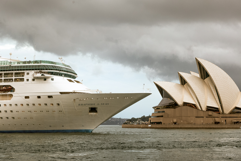 Sydney Opera House behind the cruise ship Rhapsody of the Seas