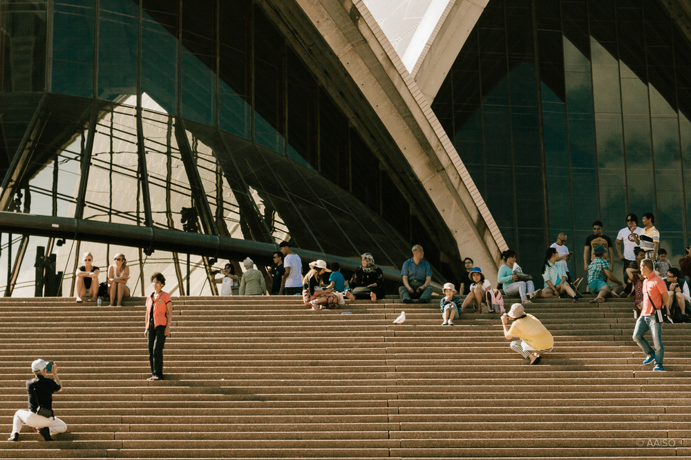 Visitors in the stairs outside Sydney Opera House